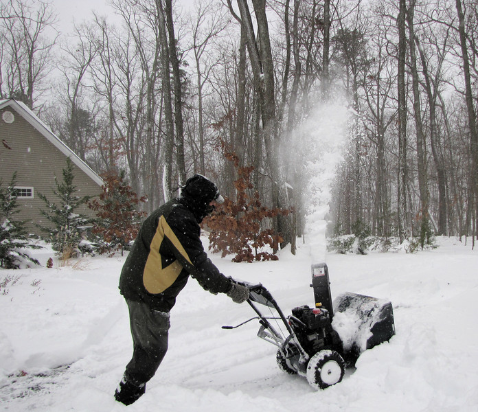 Phil Mayhew Snowblowing the Entry to Garage
