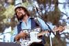 Waylon Jennings perfoming live on stage at Spartan Stadium in San Jose in 1982.