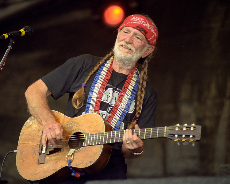 Willie Nelson performs at the New Orleans Jazz & Heritage Festival on April 23, 1999.