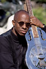 Keb Mo' with his National Steel Guitar, photographed in May 1996 in San Francisco.