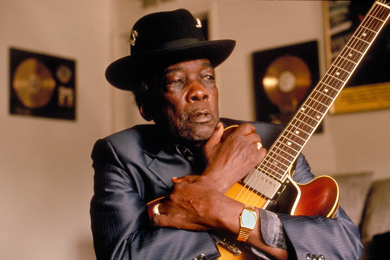 John Lee Hooker surrounded by gold records in his living room in California, 1992