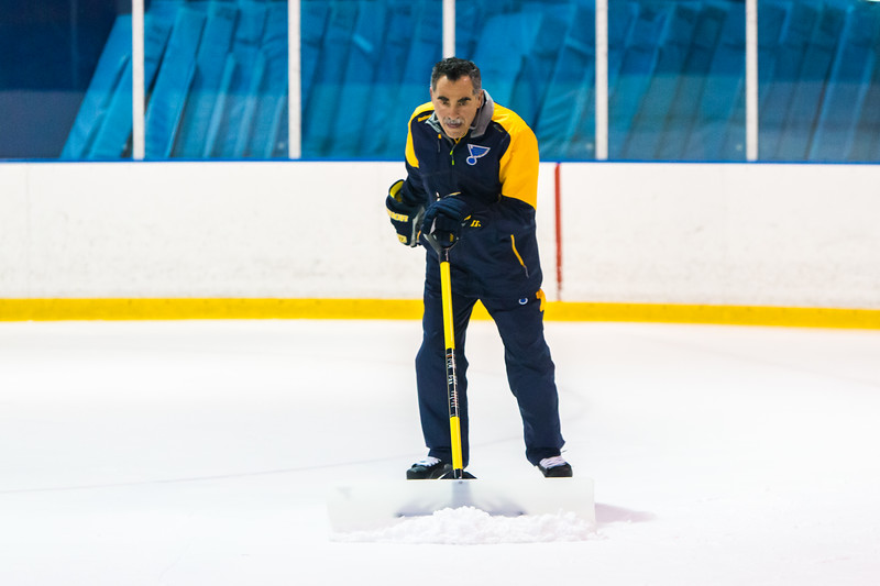 Goalie Coach Jim Corsi cleans the ice