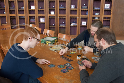 From left, Jeremiah Clark, junior in physics and mechanical engineering, James Laverty, assistant professor college of arts and sciences, and Daniel Ireton, librarian, play the game Betrayal at the House on the Hill during board game day hosted by the Games CLUB in Hale Library in Mahattan, Kan. Nov. 4, 2017. (Justin Wright | Collegian Media Group)