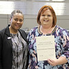 Board member Dawn Jordan-Wells with STEM & School Libraries Coordinator Kiera Elledge, in recognition of a donation from the Society for Information Management.