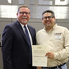 Board member Fred Campos with L.D. Bell Principal Jim Bannister, in recognition of a donation from L.D. Bell Class of 1968.