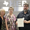 Board member Rochelle Ross and representatives from BCTEA in recognition of a donation from Ted Nielsen.
