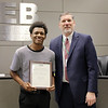 L.D. Bell High School student Mikelis Brown with Superintendent Steve Chapman, in recognition of Mikelis' accomplishments in the Rotary 4-Way Speech Contest.