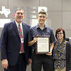 Trinity High School student Collin Williams with Superintendent Steve Chapman and Trinity teacher Stormee Massey, in recognition of Collin's accomplishments in the Rotary 4-Way Speech Contest.