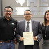 Board Member Fred Campos with Viridian Elementary principal Aungelique Brading and a representative from the Viridian Dads Club, in recognition of a donation from the Dads Club.