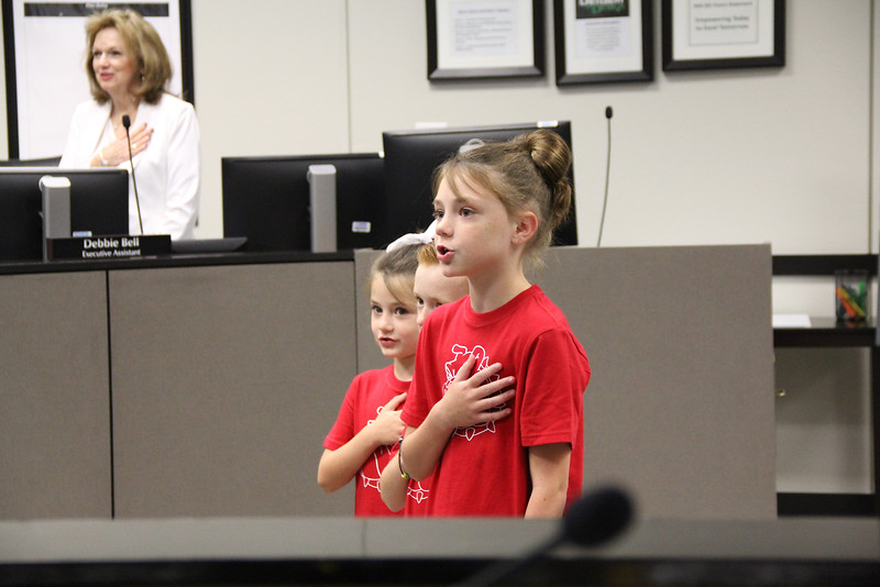 Brooklyn, Lawson, and Gracen lead the Pledge of Allegiance.