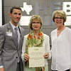 Board Member Faye Beaulieu with representatives from Texas Health Resources, in recognition of a donation from the HEB ISD Education Foundation and Texas Health Resources.