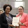 Shady Brook Elementary principal with board member, accepting certificate recognizing donation by Shady Brook Elementary PTA
