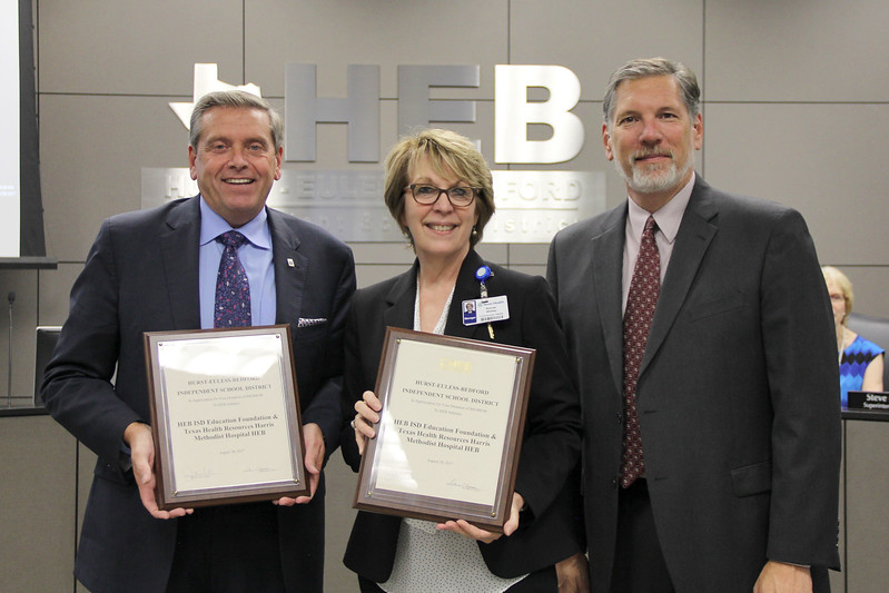 Bedford May Jim Griffin with Texas Health Resources' Brenda Whitley and the Superintendent, in recognition of the Education Foundation's and Texas Health Resources' donation.