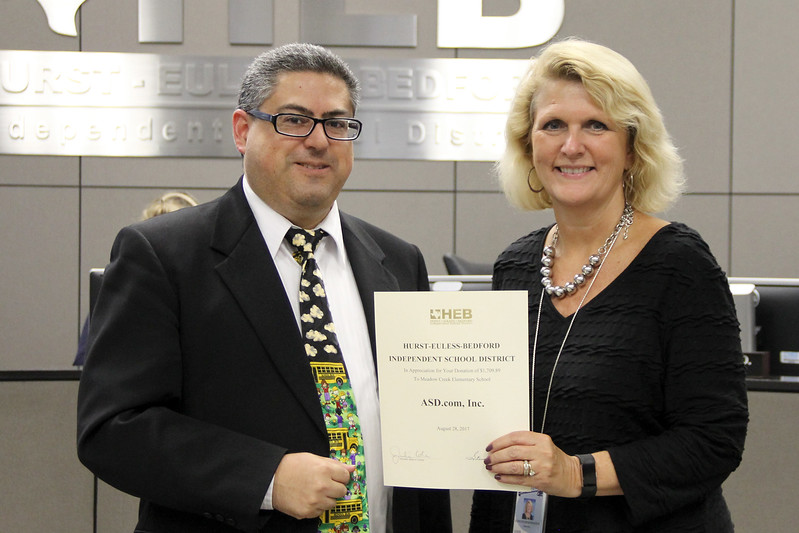 Meadow Creek Elementary principal with board member, accepting certificate recognizing donation by ASD.com, Inc.