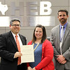 Board member Fred Campos with Bedford Junior High principal Michael Martinak & teacher Caren Lawrence, in recognition of a donation from 6 Stones Mission Network.