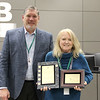 Superintendent Steve Chapman with Janice Hollingsworth of the Business Operations department. Janice is holding plaques in recognition of HEB ISD receiving the Government Finance Officers Association (GFOA) and Association of School Business Officials (ASBO) awards for financial reporting for 15 years in a row.