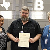 Board member Dawn Jordan-Wells with teacher Tom Hook and Career & Technical Education director Lisa Karr, in recognition of a donation from James T. Anderson.