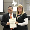Board member Fred Campos with Donna Park Elementary principal Julie McAvoy, in recognition of a donation from 6 Stones Mission Network.