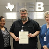 Board member Dawn Jordan-Wells with teacher Tom Hook and Career & Technical Education director Lisa Karr, in recognition of a donation from Michael Skrzynski.