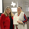 Board member Julie Cole with Oakwood Terrace Elementary principal Anmarie Garcia, in recognition of a donation from CUNA Mutual Foundation.