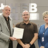 Board member Andy Cargile with James Narey from Lockheed Martin and Career & Technical Education director Lisa Karr, in recognition of a donation from Lockheed Martin.