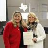 Board member Julie Cole with Meadow Creek Elementary principal Doreen Mengwasser, in recognition of a donation from the Meadow Creek Elementary PTA.