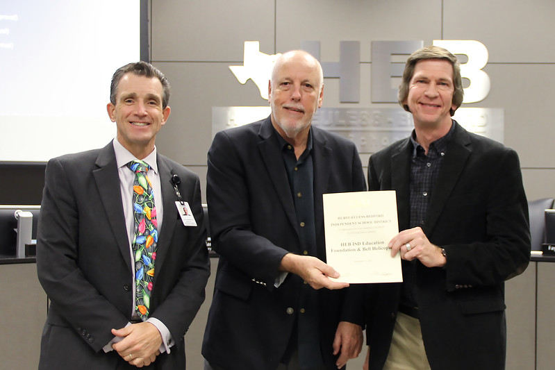 Representative from Bell Helicopter with Board Member Andy Cargile and Dr. Joe Harrington, in recognition of a donation from Bell Helicopter and the HEB ISD Education Foundation