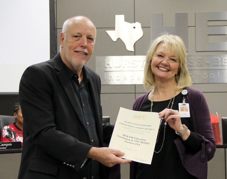 Deputy Superintendent Lydia Martin with Board Member Andy Cargile in recognition of a donation to the HEB ISD Education Foundation from NTE Mobility Partners LLC