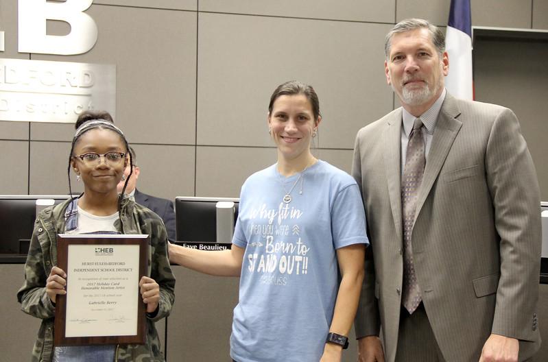 Student artist Gabrielle B. with art teacher and Superintendent Steve Chapman
