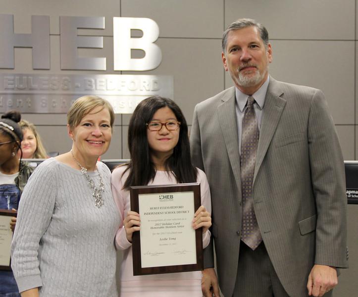 Student artist Leslie T. with art teacher and Superintendent Steve Chapman