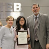 Student artist Leslie T. with art teacher and Superintendent Steve Chapman