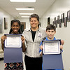 Students who led the pledge, holding certificates of recognition, standing with Euless Junior High principal Sonya Stanton