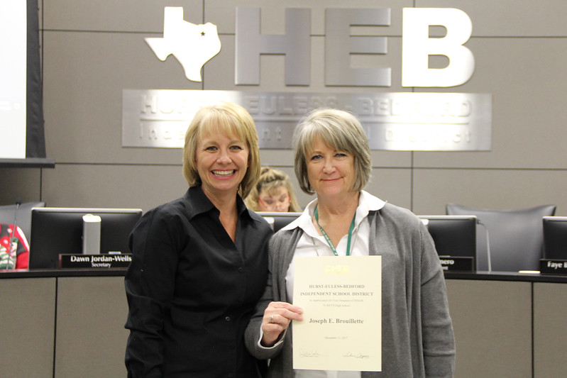Board member Rochelle Ross with a representative from KEYS High School in recognition of a donation from Joseph E. Brouillette