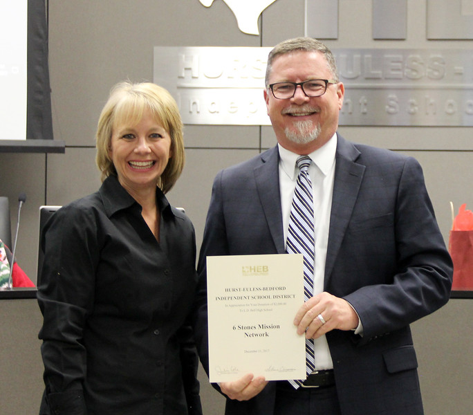 L.D. Bell High School Principal Jim Bannister with board member Rochelle Ross in recognition of a donation from 6 Stones Mission Network