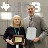 Finance Director Janice Hollingsworth with Superintendent Steve Chapman, holding awards in recognition of excellence in financial reporting