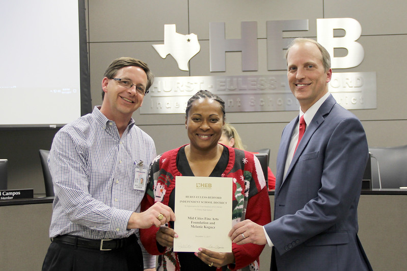 Trinity High School Principal Mike Harris with board member Dawn Jordan-Wells and Judge David Cook in recognition of a donation from Mid Cities Fine Arts Foundation