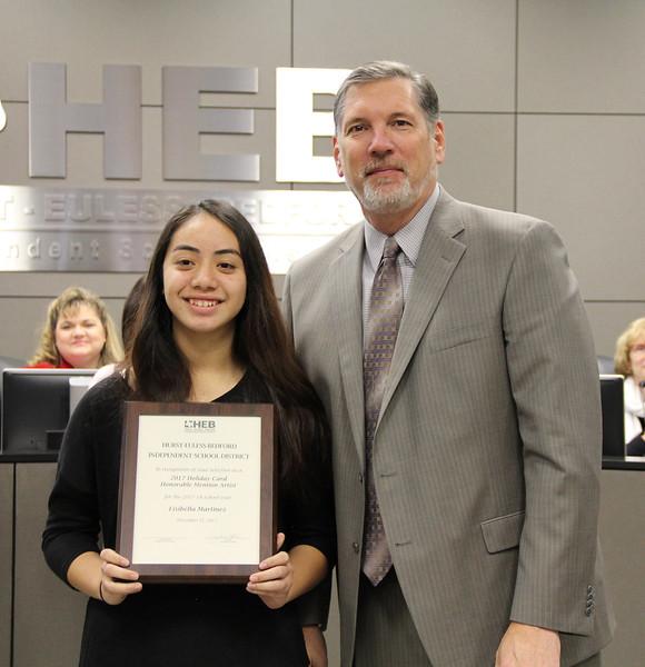 Student artist Lisabella M. with Superintendent Steve Chapman