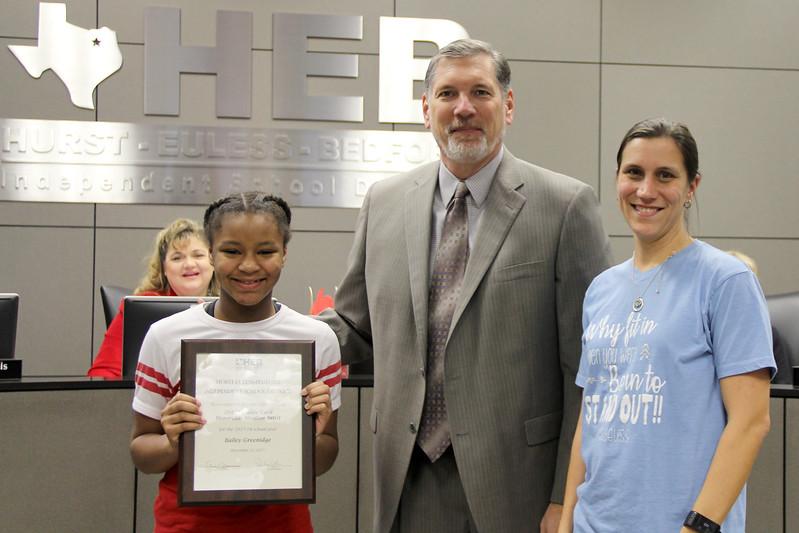 Student artist Bailey G. with art teacher and Superintendent Steve Chapman