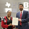 Bedford Junior High Principal Michael Martinak with board member Dawn Jordan-Wells in recognition of a donation from 6 Stones Mission Network