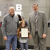 Student artist Breanna C. with art teacher and Superintendent Steve Chapman