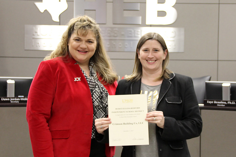 Hurst Hills Elementary Assistant Principal Marie Becker with board member Julie Cole in recognition of a donation from Crimson Building Co. LLC