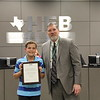 Superintendent Steve Chapman with 2019 District Geography Challenge 3rd place finisher Dane R. from Hurst Junior High.