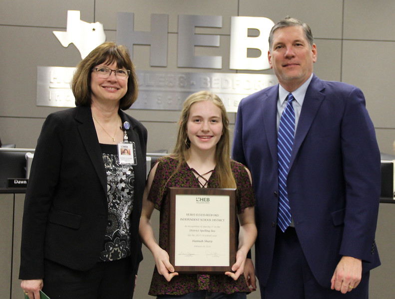 Language Arts Coordinator LaDonna Shwobel, with Bedford Jr. High student Hannah Sharp. and Superintendent Steve Chapman, in recognition of Hannah's 1st place finish in the District Spelling Bee.