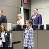 Seth W. from Shady Oaks Elementary leads the Pledge of Allegiance, with an inset photo of Seth and Shady Oaks principal Darla Clark.
