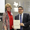 Brenda Whitley of Texas Health Resources with board member Fred Campus in recognition of a donation from Texas Health Harris Methodist Hospital H-E-B.