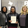 Bellaire Elementary principal Katina Rhodes, a representative from Bell Helicopter/Textron, and board president Julie Cole, in recognition of a donation from the Bellaire Elementary PTA and Bell Helicopter/Textron.