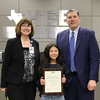 Language Arts Coordinator LaDonna Shwobel, with Hurst Hills Elementary student Elizabeth K. and Superintendent Steve Chapman, in recognition of Elizabeth's 2nd place finish in the District Spelling Bee.