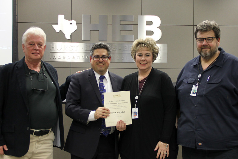 Sam Kuykendall, board member Fred Campus, Buinger CTE Academy director Lisa Karr, and teacher Thomas Hook in recognition of a donation from Sam Kuykendall.
