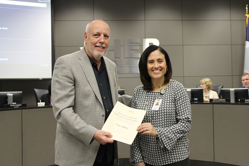 Board member Andy Cargile with Special Education director Rene Riek, in recognition of donations from the Cities of Hurst, Euless, and Bedford.