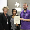 Buinger CTE Academy director Lisa Karr, board member Dawk Jordan-Wells, and teacher Derek Thorn in recognition of a donation from TransSolutions LLC.